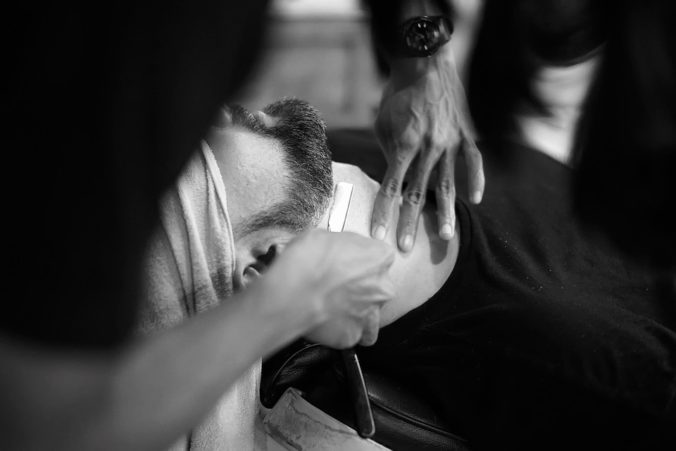 shaving at a barbershop